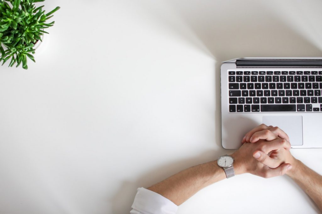 Freelance business person wearing watch near laptop: Tips for freelancers